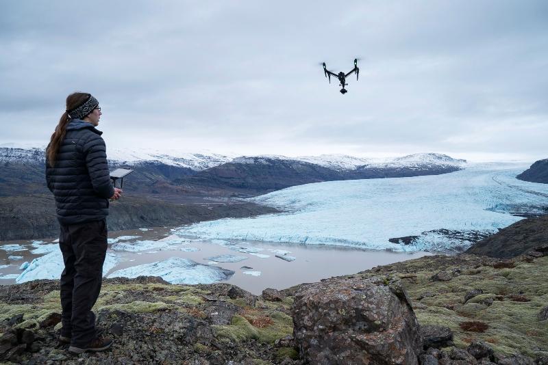 Dr Kieran flying a drone
