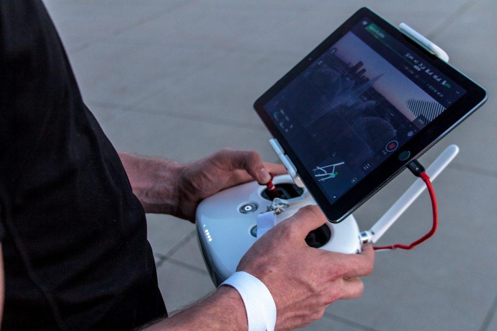 Man holding Phantom 4 Pro controller
